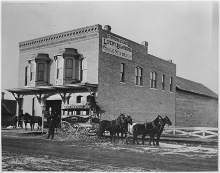 A livery stable. A place where the carriages would store thier wagons and their horses. Photo taken sometime in the early 1880s. (North Dakota Institute of Regional Studies)