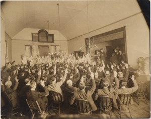 A photograph taken of a Klu Klux Klan meeting sometime in the 192?